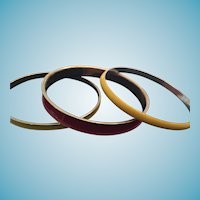 Circa 1970s Set of Three Enameled Red and Yellow Brass-Toned Metal Bangles