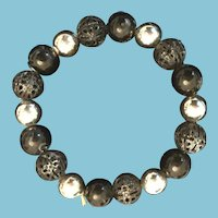 Hand-strung, Solid and Hollow Black and Luster Mauve-colored Bead Bracelet