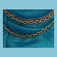 Gold Tone Four Strand Chain 'Express' Necklace