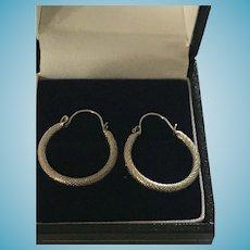 "Vintage Pair of 3/4"" Continuous Hoop Silver-Colored Pierced Earrings"