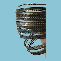 Group of 32 Gray and Copper-Toned Twisted Metal Bangles