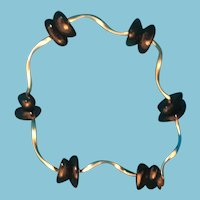 Circa 1980s Hand-strung Black Bead and Silver-Tone Bracelet