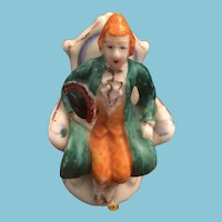 70-75 year-old, 'Made in Occupied Japan' Porcelain Ornament of a Gentleman