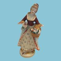 70-75 year-old 'Made in Occupied Japan' Porcelain Victorian lady Figurine