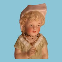 Sitting Child Fine Porcelain Figurine