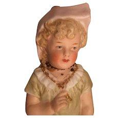 Sitting Child Fine Porcelain Figurine