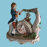 Unmarked Porcelain Gentleman and a Fine Lady on a Swing