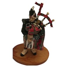 Circa 1950s Scottish Piper in Red and Green Regalia