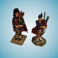 Set of Two Miniature Hand-made Porcelain Scottish Pipers in Red Tartan Regalia