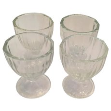 Set of Four Depression Glass Egg Cups with a Glass Maker's 'D' Mark