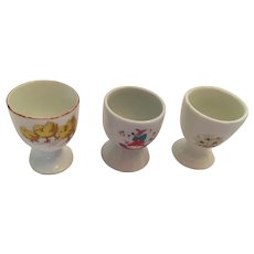 Group of Three Early Mid-Century Glazed White Porcelain Egg Cups