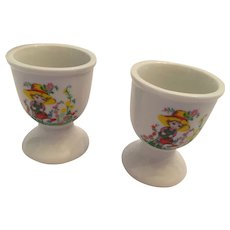 Pair of 1960s Glazed White Porcelain Egg Cups with Girl with Watering Can