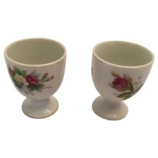 Pair of 1940s Flower Embellished, Gilt Edged, Glazed White Porcelain Egg Cups