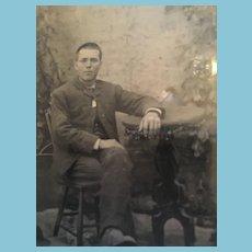 Mid-19th Century Studio Tintype of a Fine Gentlemen Sitting at a Desk.