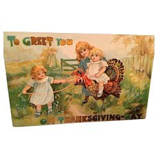 Embossed Thanksgiving Postcard with Sweet Children Riding on a Turkey