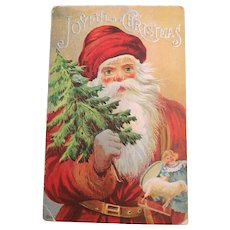 Century Old Embossed Christmas Postcard with Santa Carrying a Christmas Tree