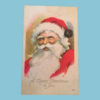 Century Old Christmas postcard with a Jolly Santa