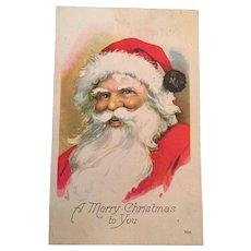 Century Old Christmas postcard with a Jolly Santa