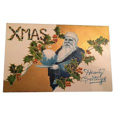 Rare Century Old Embossed Christmas Postcard with a 'Blue' Santa Claus Holding a Globe