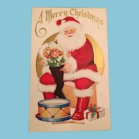 Century Old  Christmas Postcard with a Sitting Santa Claus Holding a Dolly