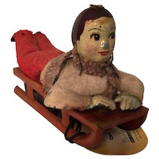 Circa 1930s FairyLite Clockwork Tin Plate Boy on a Sledge with Key