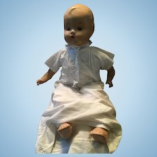 1930s Composition Baby Doll marked 'Made in Canada. A RELIABLE DOLL'.