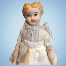 "8""  Low-Brow Blond China Head Doll"
