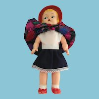 """13 1/2"""" 1940s Rubber Girl Doll with Red Bonnet"""