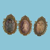 Circa 1960s Set of Three Brass-Framed 'Delightful Dolls' Jumeau Prints