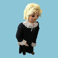 Circa 1990s Girl Mannequin in a 'Milton Funware' Lace-Trimmed Dress