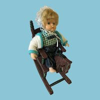 "9 1/2"" (sitting) Porcelain Toddler Doll and Wooden Rocking Horse"