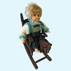 "9 1/2"" (sitting) Porcelain Toddler Doll and Wooden Rocking Horse"