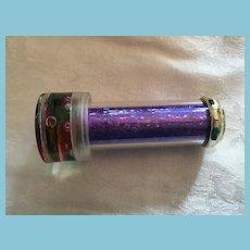 "Vintage Plastic 3 1/4"" toy Kaleidoscope with Purple Glitter Stem"