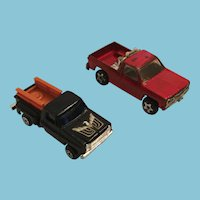 Two Diecast Pick-up Trucks - ERTL Dyersville Iowa Red Truck and Eagle Black Truck