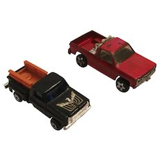 Two Diecast Pick-up Trucks - ERTL Dyersville Iowa Red Truck and Eagle Black Truck