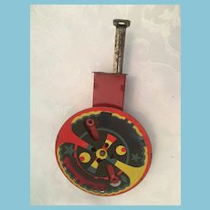 Circa 1930s Whirling Push Plunger Mechanical Tin Toy