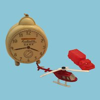 group of three vintage toys - Corgi helicopter, Reliable Bank, Carzol Truck