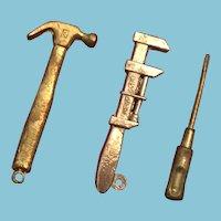 "Group of Three 1 1/4"" Miniature Diecast Tools"