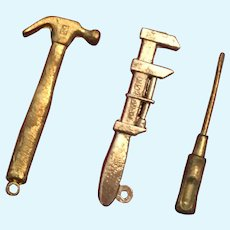 "Group of Three 1 1/4"" Miniature Diecast Tools"