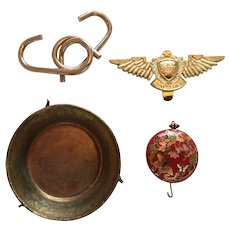Four Eclectic Collectibles: Pendant, Dish, Puzzle, and 'Sky Cadet Corps' Wings