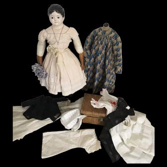 Very large Antique Voit Child Head Papier Mache Doll with Trousseau, ca. 1840