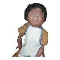Charming primitive Black doll