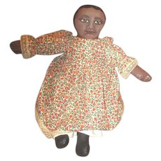 Primitive Black doll with painted face