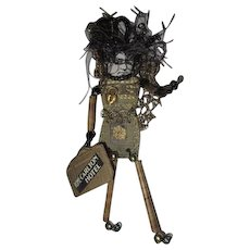 Unique altered art doll