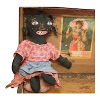 Great vintage black embroidered doll