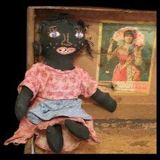 Great vintage black embroidered doll