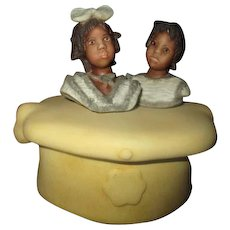 Black doll heads container by Annette Himstedt