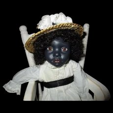 Adorable black  bisque doll by Jude Kapron