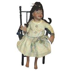 Sassy black bisque doll