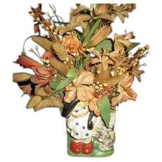 Flowers in kid vase
